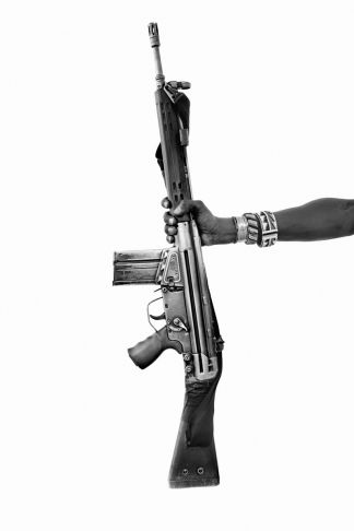 Lyle Owerko - Likileti Lelesit (holding automatic rifle)